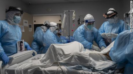 Medical workers treat a patient with Covid-19 in the Covid-19 intensive care unit at United Memorial Medical Center on October 31, 2020 in Houston, Texas.