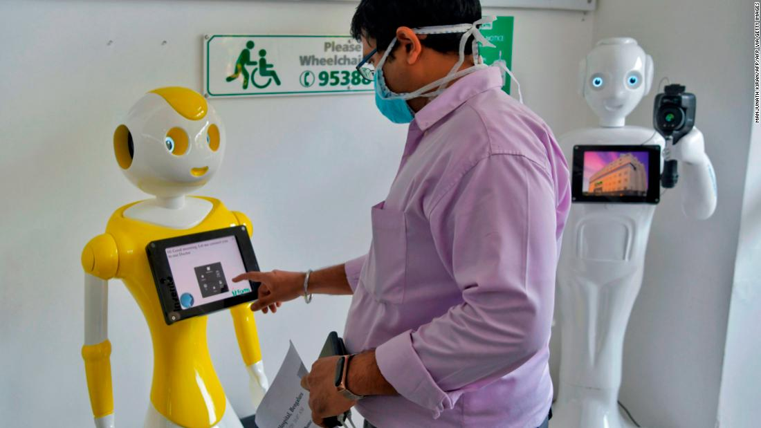 """Mitra,"" developed by Invento Robotics, at work at at Fortis hospital in Bangalore. <strong>Scroll through the gallery for more examples of robots that are doing good.</strong>"