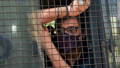 Indian television news anchor Arnab Goswami sits inside a police vehicle after he was taken to court following his arrest in Mumbai on November 4.