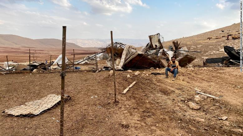 A man sits at the site of the demolition in Khirbet Humsa on November 4.