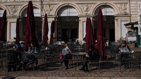 People wearing masks at Piazza San Carlo in Turin on Thursday, the last day before new lockdown measures for the Italian region of Piedmont.