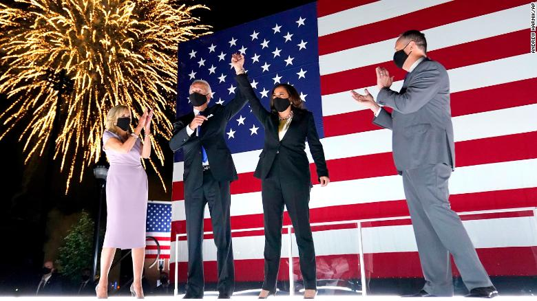 Former Vice President Joe Biden and with Democratic running mate Sen. Kamala Harris raise their arms up as fireworks go off in the background during the fourth day of the Democratic National Convention, Thursday, August 20, 2020.