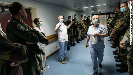 Soldiers are welcomed to the Bois de l'Abbaye hospital in Seraing, in Belgium's Liege province, on November 2.