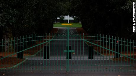 A view of the locked gates at the entrance of Magnolia Lane at Augusta National.