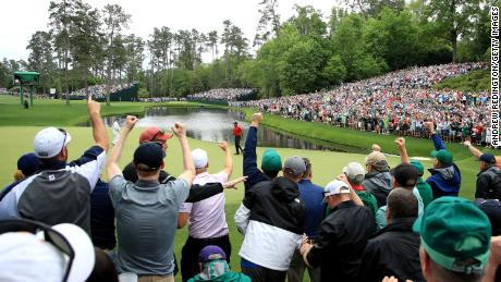 Patrons cheer as Tiger Woods celebrates his birdie on the 16th green during the final round of the Masters in 2019.