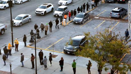 People queue to vote in Des Moines, Iowa.