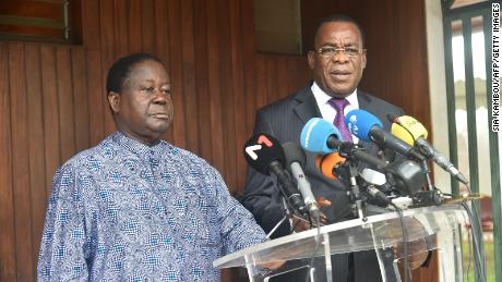 Former Ivorian president Henri Konan Bedie and former PM Pascal Affi N'Guessan speak to the press in Cocody, Abidjan, on October 15, 2020.