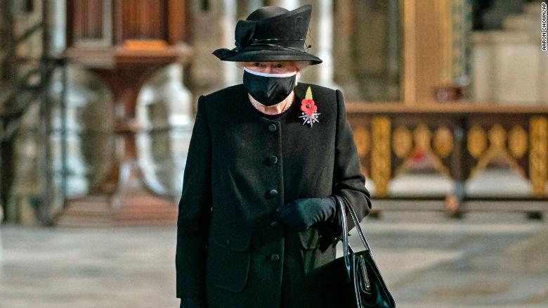 Britain's Queen Elizabeth seen in face mask for first time during public ceremony