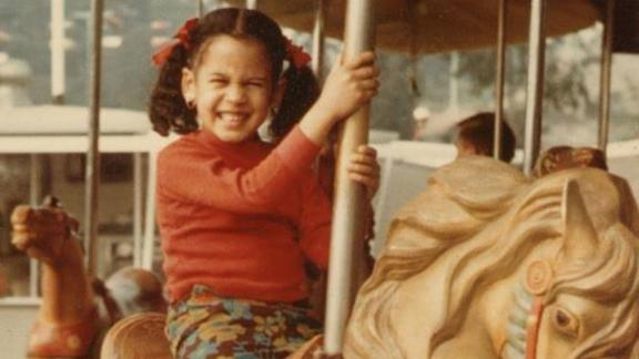 Harris rides a carousel in this old photo she posted to social media in 2015. Her name, Kamala, comes from the Sanskrit word for the lotus flower. Harris is the daughter of Jamaican and Indian immigrants and grew up attending both a Baptist church and a Hindu temple.