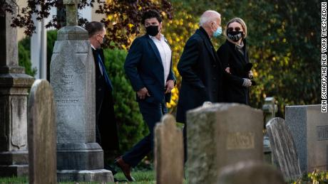 Former Vice President Joe Biden, the Democratic presidential nominee, walks arm in arm with his granddaughter Finnegan Biden as they arrive to visit the grave of his son Beau Biden at St. Joseph on the Brandywine Church in Wilmington, Del., on Election Day morning.