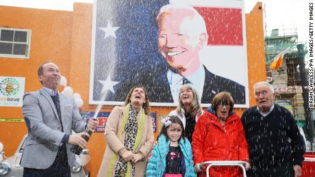 Joe Blewitt (left), Joe Biden's cousin, with (from left) wife Deirdre, daughter Lauren (7 years old), Emer Bourke, Aunt Breege Bourke and father Brendan Blewitt as they started celebrating over anticipation of the results of United States Elections.