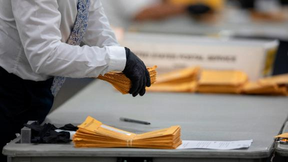 DETROIT, MI - NOVEMBER 04: A worker with the Detroit Department of Elections helps sort through absentee ballots at the Central Counting Board in the TCF Center on November 4, 2020 in Detroit, Michigan. President Trump narrowly won Michigan in 2016, and both he and Joe Biden campaigned heavily in the battleground state in 2020. (Photo by Elaine Cromie/Getty Images)