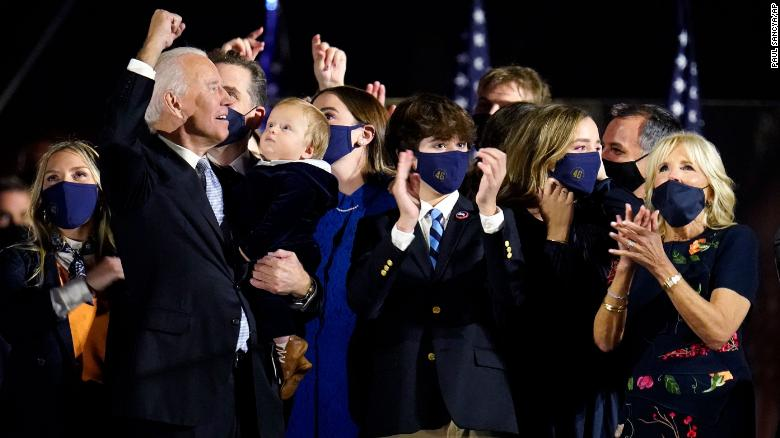 Biden and Harris share the spotlight with their families to celebrate victory
