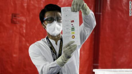 An official of the Union Election Commission counts ballots at a polling station on November 8 in Yangon, Myanmar.