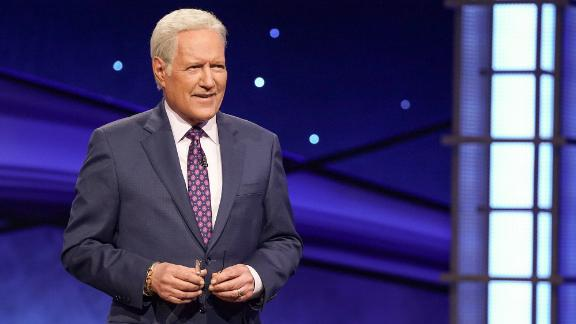 """<a href=""""https://www.cnn.com/2020/11/08/entertainment/alex-trebek-jeopardy-host-death-trnd/index.html"""" target=""""_blank"""">Alex Trebek</a>, the genial """"Jeopardy!"""" host with all the answers and a reassuring presence in the TV game-show landscape for five decades, died November 8 at the age of 80. Trebek revealed in March 2019 he had been diagnosed with stage 4 pancreatic cancer, triggering an outpouring of support and well wishes at the time."""