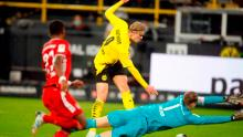 Dortmund's Norwegian forward Erling Braut Haaland (C) scores Dortmund's second goal in the 3-2 defeat by Bayern Munich.
