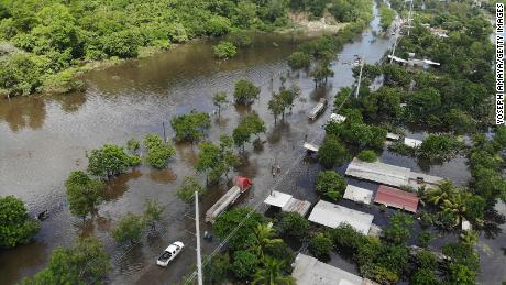 A community road leading to Puerto Cortes is seen after it was flooded by tropical storm Eta on November 8, 2020 in Rio Nance, Honduras.