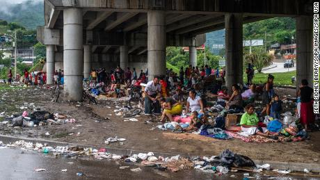 People forced from their homes in the San Pedro Sula Valley due to flooding in the aftermath of Hurricane ETA have taken refuge in a makeshift camp under an overpass in Chimelikon, Honduras.