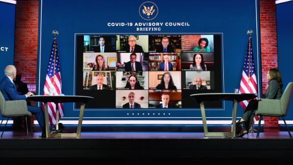 US President-elect Joe Biden(L) and US Vice President-elect Kamala Harris speak virtually with the Covid-19 Advisory Council during a briefing at The Queen theatre on November 9, 2020 in Wilmington, Delaware.