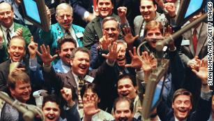 Traders cheer on the floor of the New York Stock Exchange in March 1999, as the Dow hit the 10,000  mark for the first time. By the end of the month it would close above that level.