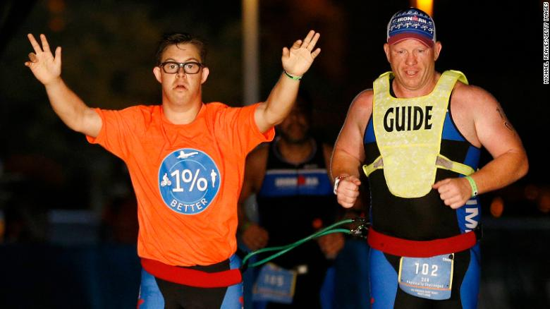 A 21-year-old man has made history as the first person with Down syndrome to complete an Ironman triathlon