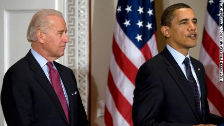 President Barack Obama speaks to the National Conference of State Legislatures as U.S. Vice President Joseph Biden looks on in the Eisenhower Executive Office Building of the White House on March 20, 2009 in Washington, DC.