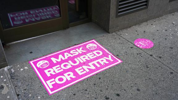 NEW YORK, NEW YORK - AUGUST 23: A 'mask required for entry' sign is displayed at the entry to a retail store during Phase 4 of re-opening following restrictions imposed to slow the spread of coronavirus on August 23, 2020 in New York City. The fourth phase allows outdoor arts and entertainment, sporting events without fans and media production.  (Photo by Cindy Ord/Getty Images)