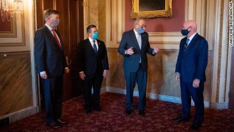 Senate Minority Leader Chuck Schumer, D-N.Y., center right, meets with Sen.-elect John Hickenlooper, D-Colo., left, Sen.-elect Ben Ray Luján, D-N.M.,and Sen.-elect Mark Kelly, D-Ariz, in Washington on Monday, November 9.