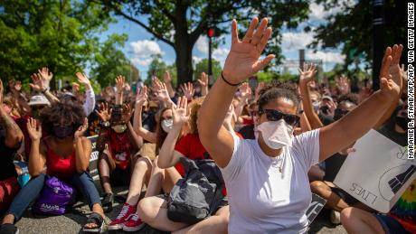 Protesters raise their hands during a demonstration against racism and police brutality in Pittsburgh, Pennsylvania, on June 6, 2020