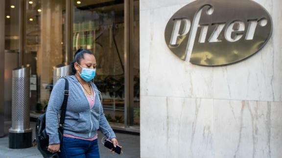NEW YORK, NY - NOVEMBER 09: People walk by the Pfizer headquarters on November 9, 2020 in New York City. Pharmaceutical company Pfizer announced positive early results on its COVID-19 vaccine trial and has proven to be 90% effective in preventing infection of the virus. (Photo by David Dee Delgado/Getty Images)