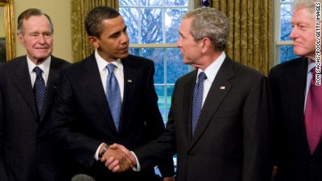 Presidents George W. Bush and Barack Obama have been credited with a near-flawless transition that included providing loans to keep GM and Chrysler afloat during the Great Recession. The two met in January 2009 before Obama took office along with President Bill Clinton and Bush's father, President George H. W. Bush.