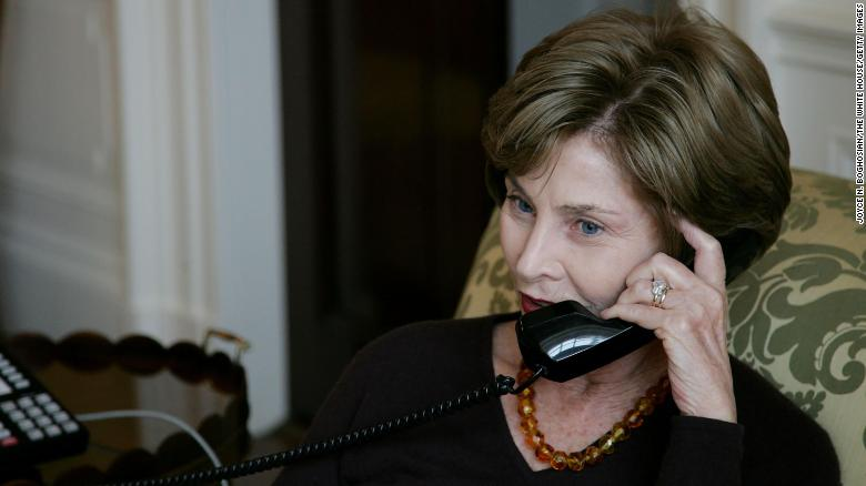 In this White House photo, first lady Laura Bush talks to Michelle Obama by telelphone at the White House November 5, 2008.