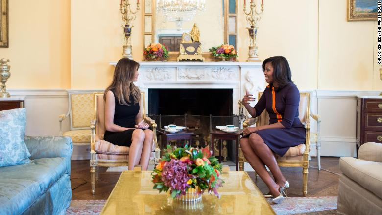In this White House photo, first lady Michelle Obama meets with Melania Trump for tea in the Yellow Oval Room of the White House, November 10, 2016.