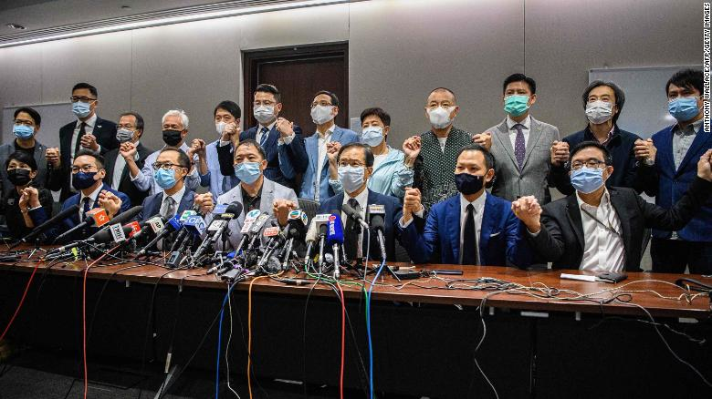 Pro-democracy lawmakers join hands at the start of a press conference in a Legislative Council office in Hong Kong on Wednesday.