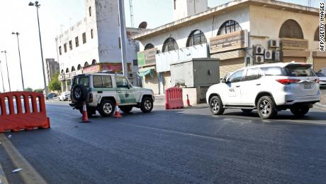 Saudi police close a street leading to a non-Muslim cemetery in Jeddah where a bomb struck a World War I commemoration.