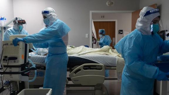 HOUSTON, TX - NOVEMBER 10: (EDITORIAL USE ONLY) Medical staff members treat a patient suffering from coronavirus in the COVID-19 intensive care unit (ICU) at the United Memorial Medical Center (UMMC) on November 10, 2020 in Houston, Texas. According to reports, COVID-19 infections are on the rise in Houston, as the state of Texas has reached over 1,030,000 cases, including over 19,000 deaths.  (Photo by Go Nakamura/Getty Images)