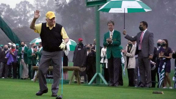 Honorary starter Jack Nicklaus waves to the few patrons gathered for his ceremonial tee shot on the first hole ahead of the first round.