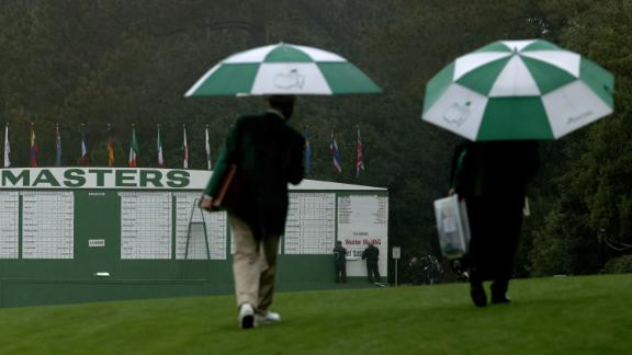 """The scoreboard is updated with a """"Weather Warning"""" and """"Play Suspended"""" sign after lightning and rain caused play to be halted after just 30 minutes on the first day."""