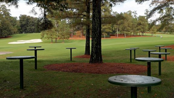 Empty tables are seen near the course during the first round. Patrons have not been allowed to attend the tournament due to the coronavirus pandemic.