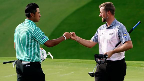 Webb Simpson (right) fist pumps Hideki Matsuyama (left) on the ninth hole after their first round.