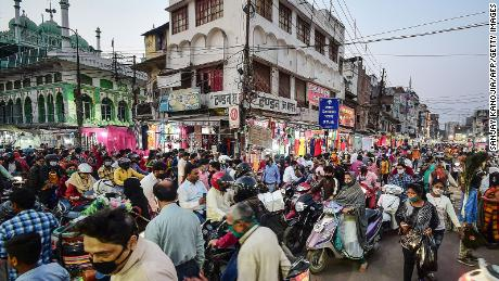 People gather at a market for shopping ahead of Diwali or the Hindu festival of light in Allahabad on November 12, 2020.