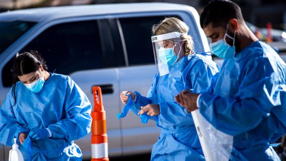 Medical workers put on personal protective equipment (PPE) before starting shifts at a Covid-19 drive-thru testing site in El Paso, Texas, U.S., on Monday, Nov. 9, 2020. Texas recorded more than 9,000 new cases in a 24-hour period last week, the steepest daily increase since Aug. 4, according to state health department figures.Photographer:  via Getty Images