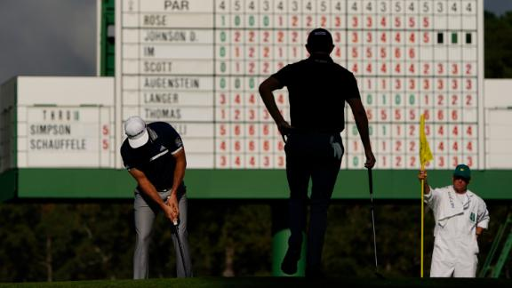 Patrick Cantlay watches as Dustin Johnson putts on the 17th hole during the first round of the Masters.
