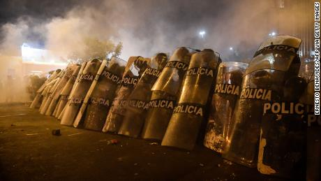 Riot police take positions during protests on November 12.