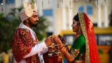 A bride and a groom pose for a photograph ahead of a mass wedding ceremony in Surat in December, 2019.