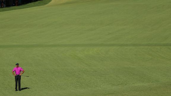 Tiger Woods of the United States looks on  the second hole during his third round of 72 to fall 11 shots behind Johnson.