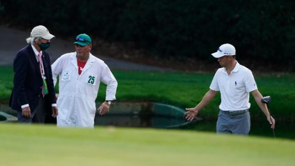 Justin Thomas takes to a rules official after hitting his ball in the water on the 15th hole.