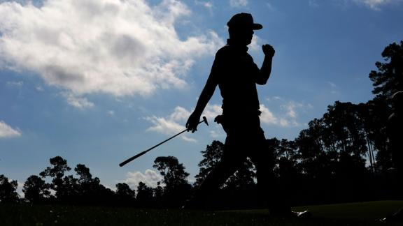 Sungjae Im, of South Korea, walks down the fourth fairway in his final round of 69 which left him tied with Cameron Smith on 15-under.