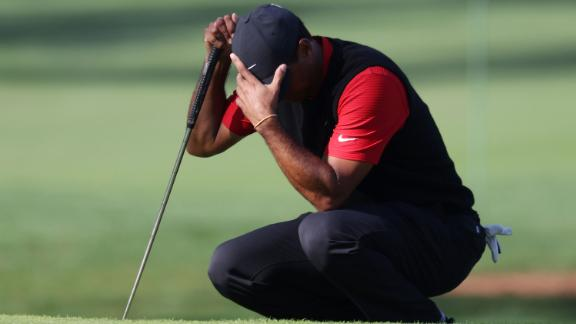 Tiger Woods of the United States reacts on the seventh green during his topsy-turvy round which included a 10 on the short 12th.