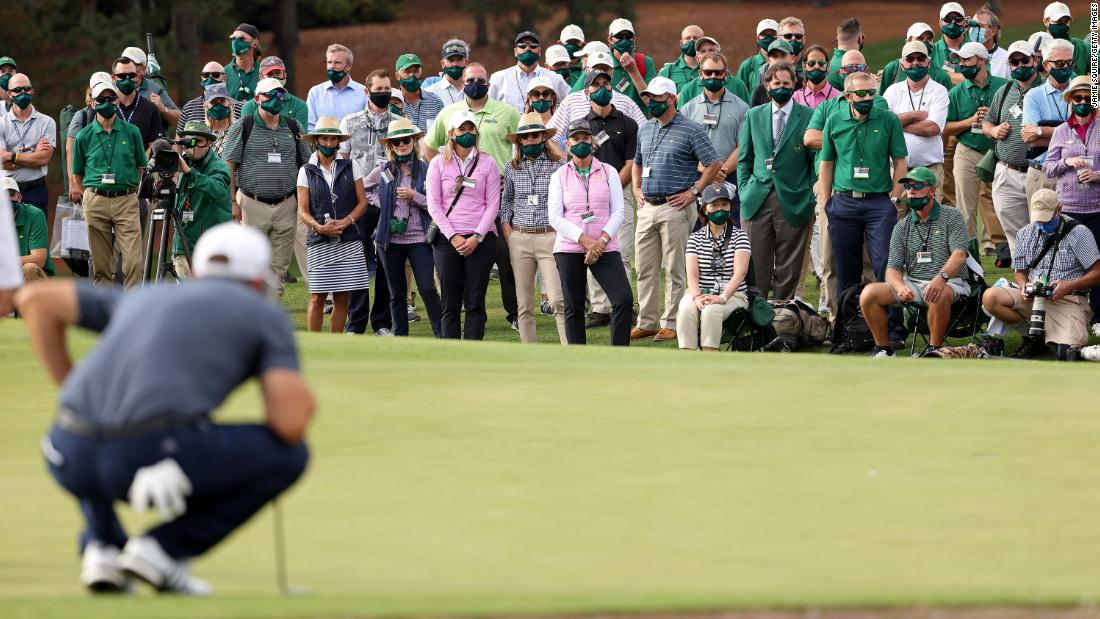 A view of the gallery as Dustin Johnson of the United States lines up a putt on the 18th green before claiming victory.